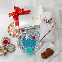 Beads and Pearl Rakhi and a Box Candies 2 chocolates and a Thali