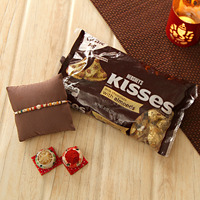 Beads Rakhi with a pack of Kisses chocolates and roli-chawal kit