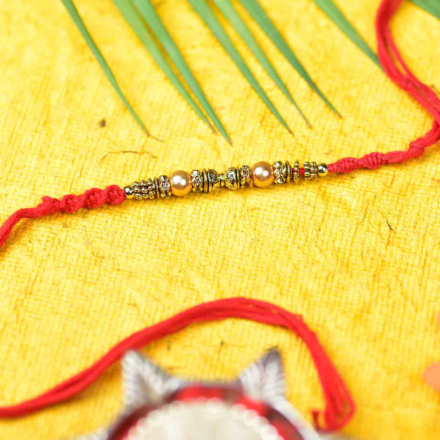 Antique Work Rakhi with Beads