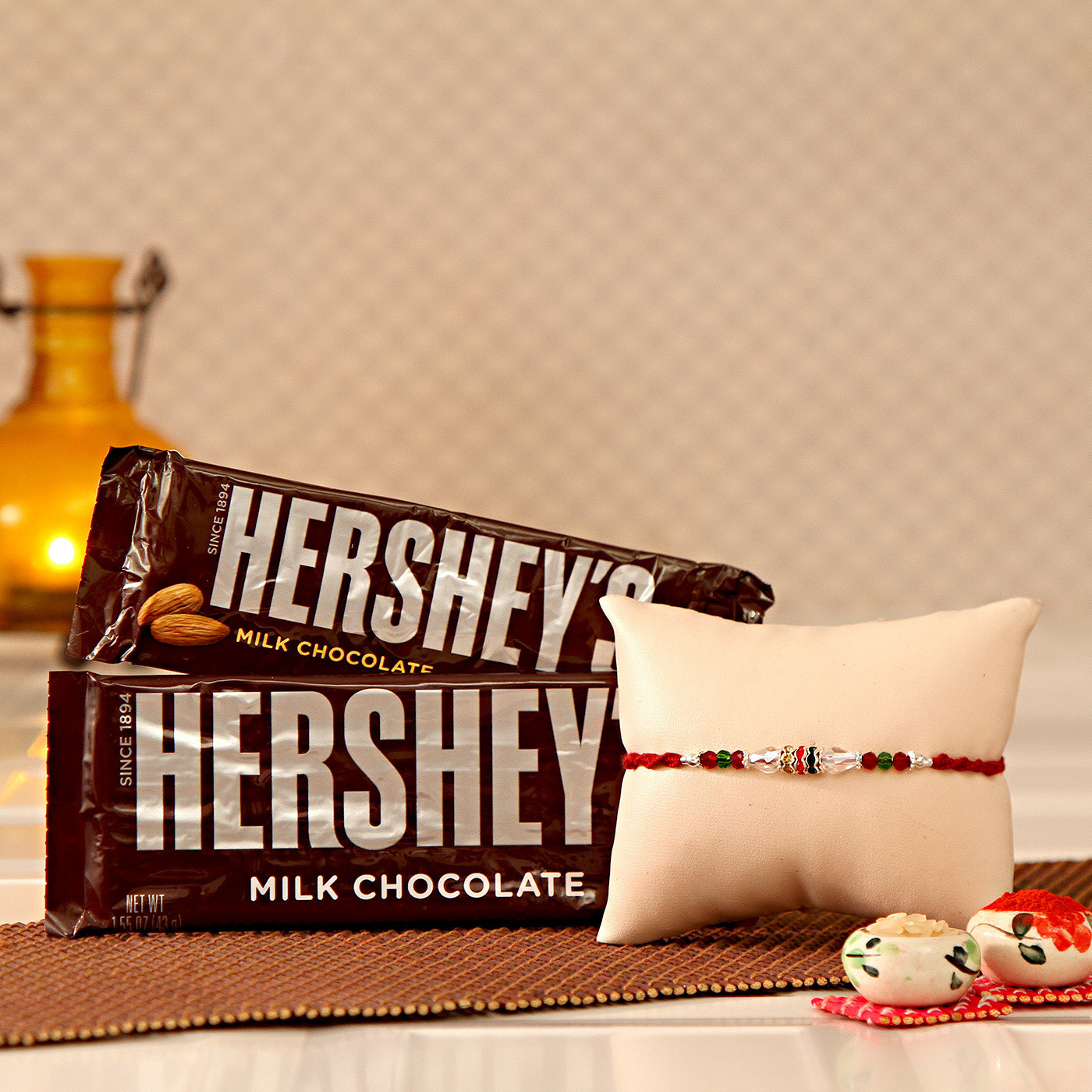 Rakhi with Two Bars of Hershey\'s Chocolates and a Roli-Chawal Kit